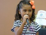 6yr old club member Melissa Aguilar singing