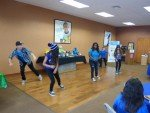 Teens from the club peforming a hip hop routine for the talent show later that afternoon