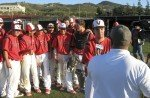 1he Vista players are all smiles, while teammate Nick Longoria is interviewed by KUSI after the game.