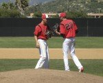 Vista players chat on the mound.
