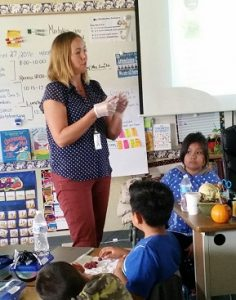 Amy Haessly, Vista Unified nutrition education and training supervisor, going over food labels with third grade class.