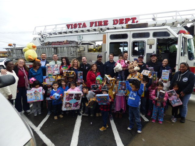 Fire Department Christmas Gifts Part - 33: The Vista Fire Department, Assisted By City Council Members, John Aguilera,  Amanda Rigby And Joe Green, Visited A Pre-school In Vista On California  Avenue ...